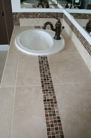 tiling ideas bathroom top: tiled bath counter top with dark marble accent tile tile countertop marble