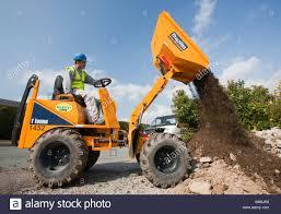 a builder driving a mini dumper truck on a house extension a builder driving a mini dumper truck on a house extension building job ambleside cumbria uk