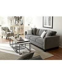 living room space features mocha fabric sofas kenton fabric sofa living room furniture collection