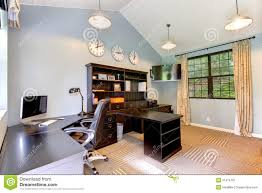 blue modern home office with dark brown furniture blue home offices