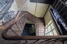 adam x chateau de la chapelle urbex urban exploration belgium abandoned stairs staircase bannisters ballustrade chateau de la chapelle belgium