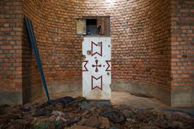 photos rwanda genocide 20th anniversary com clothes of victims killed during the rwandan genocide laid out before the alter riddled