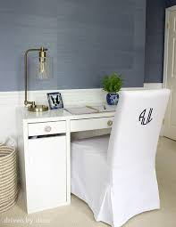chic girls room boasts upper walls clad in walls republic sisal powder blue grasscloth and lower walls clad in wainscoting lined with an ikea micke desk chic ikea micke desk white