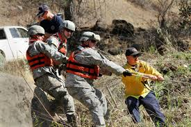 u s department of defense photo essay california army national guardsmen work cal fire s jeremy salizzoni right military liaison and