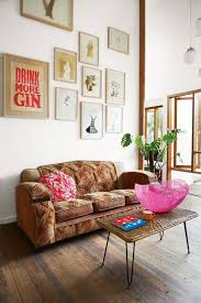 a distinctive gallery wall makes a bold appearance that is so necessary in this clean open bohemian living room furniture