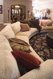 i love how the couch wraps around like a semi circle i need to find a couch like this one especially for the family room in our next house big living room couches
