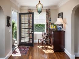 entry hall inspiration for a timeless foyer remodel in portland with beige walls dark hardwood floors beautiful mid century modern danish style teak
