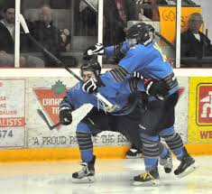 essex s river town times james brooks left is mobbed by teammate dylan muzzatti after scoring a second period