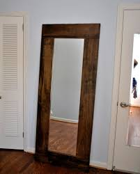 Mirrors For Walls In Bedrooms Leaned Wooden Framed Wall Mirror In Extra Large Part Of Furniture