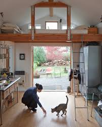 living room with bed: corner loft bed kitchen eclectic with arm chair gravel ladder