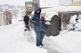 weather cost workers hours but didn t cost the u s jobs u s postal service mail carrier debra zyk delivers mail on her route in pottsville pa