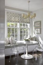room bench seating backs high breakfast nook in back corner with french doors to the