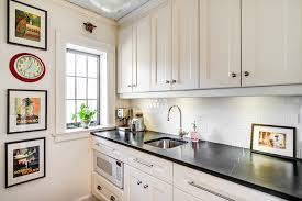 tile backsplash pictures kitchen traditional with additions architect black counter1 bright modern laundry room