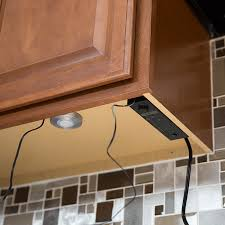 power control mounted underneath upper cabinets cabinet lighting puck light