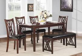 small dining tables sets: six piece dining set with bench with a cherry finish and upholstered chairs and bench