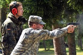 u s department of defense photo essay u s army spc andrew maclaren right fires the german p8 pistol under the