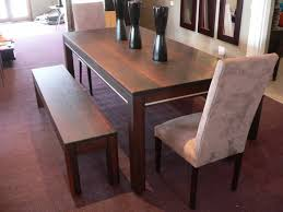 long wood dining table: contemporary long dining room bench made of textured wood with no back full size
