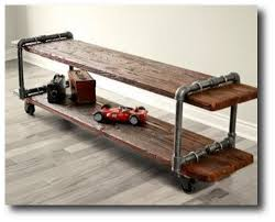 make your own vintage industrial cast iron pipe table tv stand with plumbing parts and old black steel pipe furniture