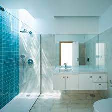 bathroom box  futuristic bathroom interior design with glass box shower corner and lighting on ceiling including blue tile