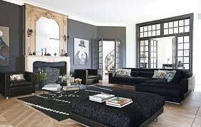 living room furniture spaces inspired: contemporary interior living room with dark sofa near fireplace mantel