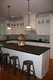kitchen design entertaining includes: the creation of outdoor spaces and opening the views to the outdoors was a priority in