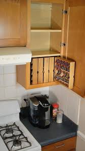 upper kitchen cabinets pbjstories screenbshotb: kcup storage for kitchen cabinet right hand cabinet by donalddavie  love this idea