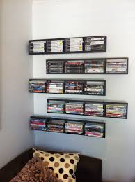 space living ideas ikea: wall mounted floating five levels black furnished wood shelves for cool dvd storage idea on