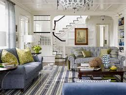 beach themed living room ideas with striped rug and blue couch and decorative ceiling lamp and green pillows blue couch living room ideas
