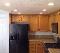 kitchen linear dazzling lights clear ceiling recessed: cute kitchen recessed simple kitchen recessed lights line shape ceiling downlights brown oak wood kitchen cabinets brown marble countertop built in fridge built in stoves oven kitchen recessed lights lighting dazzling des