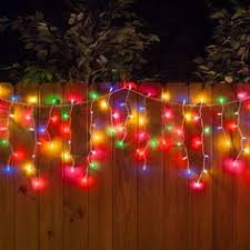 party lights idea hang multicolor christmas icicle lights along the fence to brighten the backyard backyard party lighting