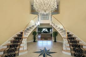 foyer with double stairs and star floor design brilliant foyer chandelier ideas