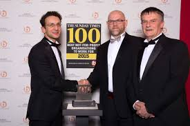 great at number new charter reaches top in best uk company l r nick rodriguez from the sunday times new charter group chief executive ian munro and deputy chief executive martin frost