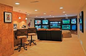 a finished basement for the avid sports fan who can watch up to 9 games at basement sports bar ideas
