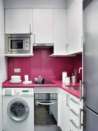 apartment kitchen design: mesmerizing bright kitchen cabinets with silver oven and cute laundry machine then magenta pink backsplash design