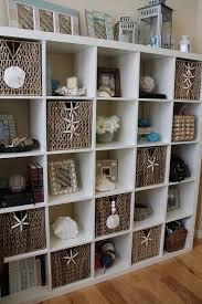 decorating with shells storage bookcase bookshelf shelf shelving baskets starfish coastal beach house ocean sea decor beach office decor