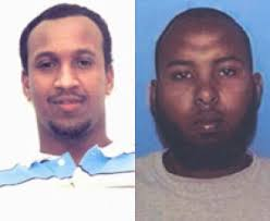 ... left, and Kasim Mohamed of Edmonton, right. ((Edmonton Police Service)) - edm-hassanmohamed
