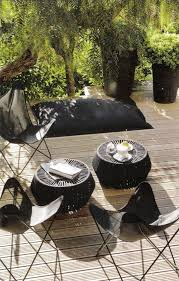 potted pittosporum and butterfly chairs cote sud via linen and lavender black outdoor furniture