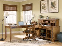 excellent office space design presented with desk lamp which has same style with stand lamp installed with rustic home office desks in the middle beautiful home office desk
