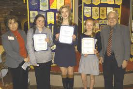 essay contest students whose essays were judged the top three of entries for seventh and eighth grade students