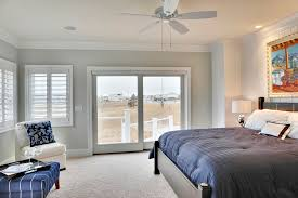plantation shutters for sliding in bedroom beach with ceiling fan accent wall baseboards ceiling fan