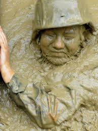 u s department of defense photo essay u s navy seaman schwertman emerges from the muddy water at the jungle warfare training center s