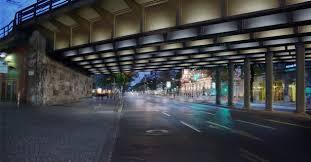 artist hans peter kuhns playful lighting design concept turned rail bridges into night time works lighting design images