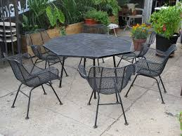 amazing black iron dining chairs and matching dining table by woodard furniture for patio furniture ideas amazing patio furniture home