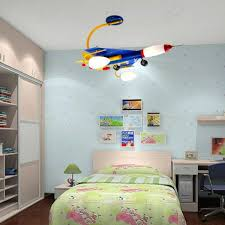 ceiling light fixtures childs bedroom above green lamp shade over low profile bedside table across 17 bedroom lighting bedroom ceiling lights bedside