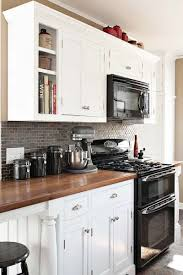 black appliance matte seamless kitchen: how to decorate a kitchen with black appliances and white cabinets ideas and updates