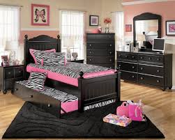 black stained wooden trundle bed in teenage bedroom added dresser and vanity dressing table with mirror bedroom furniture for tweens