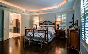 british colonial furniture bedroom traditional with hand scraped dark hardwood flooring caribbean bedroom furniture