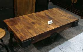 coaster rustic brown finish wood and rustic wheels country finish low end table brown finish solid wood table tops factory cart coffee table reclaimed wood cheap reclaimed wood furniture