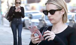 Emma Roberts pairs denim with a black top and <b>leopard print</b> shoes ...