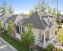 New Orleans House Plans Interior Courtyards Home Design Ideas    This is an example of a mid sized traditional beige two story exterior in